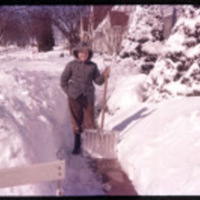 Kent Liska with snow shovel, 1950s