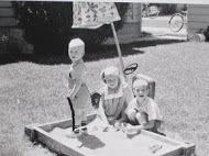 Inhorn Children in Sandbox, (L-R) Rodger, Marcia, Lowell, cir. 1962.JPG
